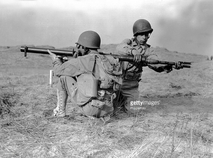October, 1943, Two soldiers of the American army loading up a bazooka gun during training exercises in England during World War Two